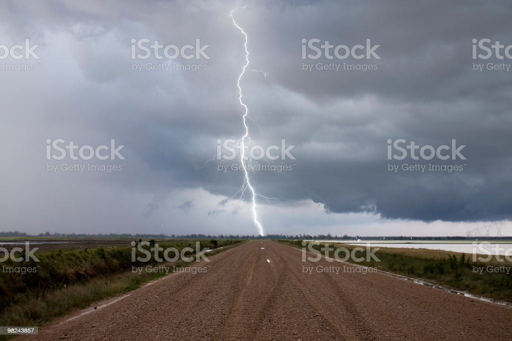 Lightning over road royalty-free stock photo