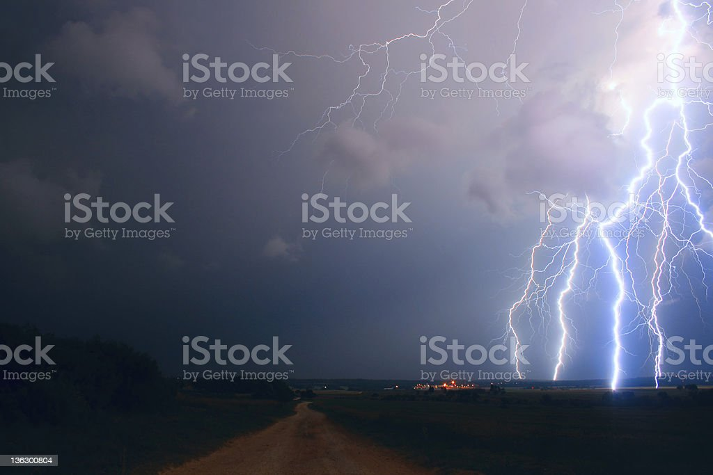 Lightning over the field stock photo
