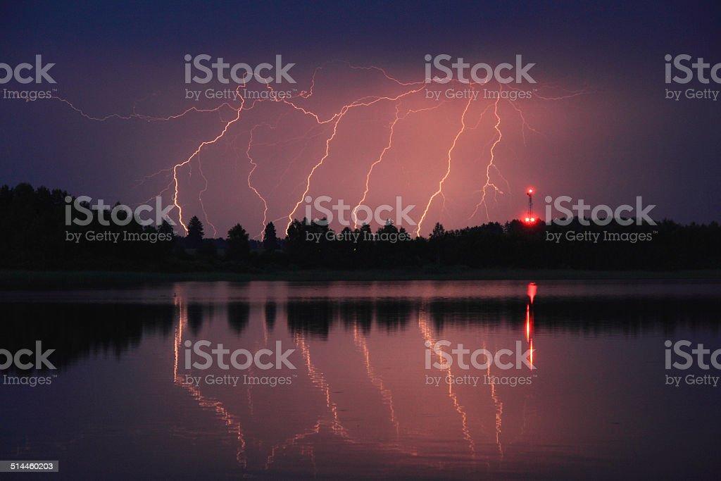 lightning over the lake stock photo