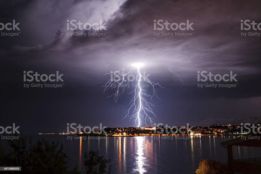Lightning over the seaside stock photo