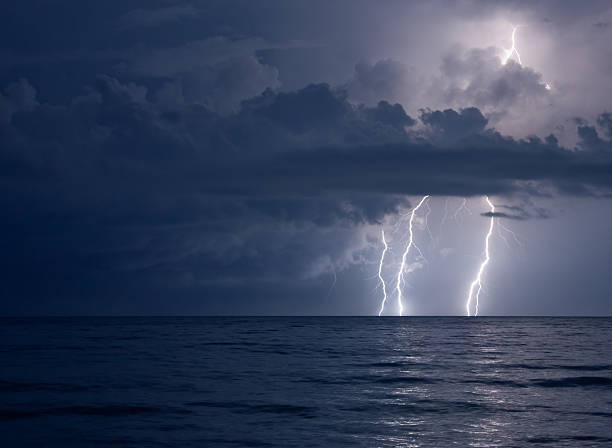 lightning over water stock photo