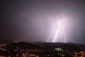 Image of lightning bolt over city