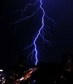 A gorgeous bolt of lightning over a dark landscape