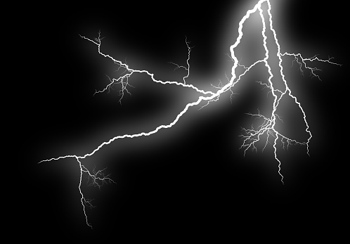 Close-up of lightning piercing night sky, Isolated on black background