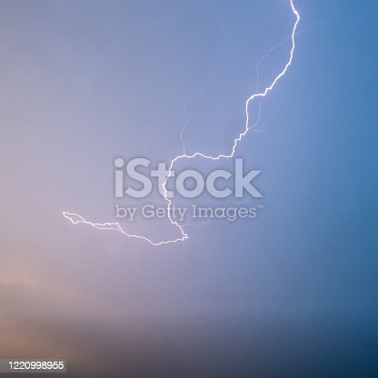 503731700 istock photo Lightning shoots across a clear evening sky 1220998955
