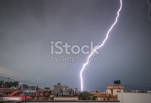 503731700 istock photo Lightning shoots across a clear evening sky 1220998967
