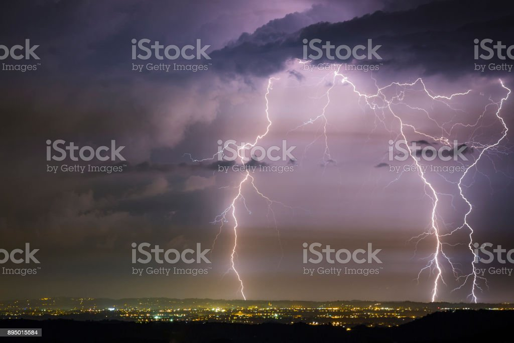 Lightning show over city stock photo