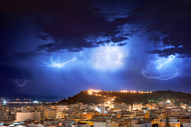 lightning storm at night stock photo