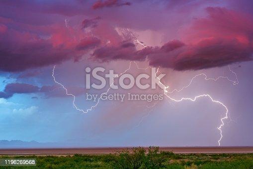 1039163636 istock photo Lightning storm at sunset 1196269568