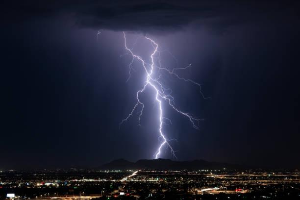 Lightning storm over a city stock photo
