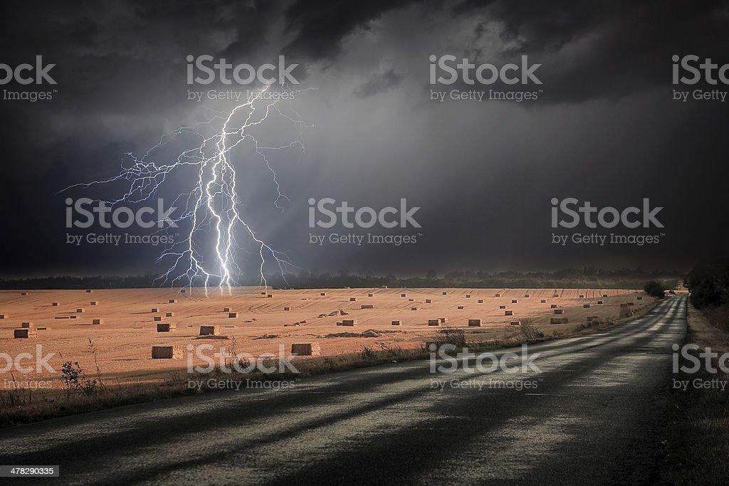 Lightning storm over asphalt road royalty-free stock photo