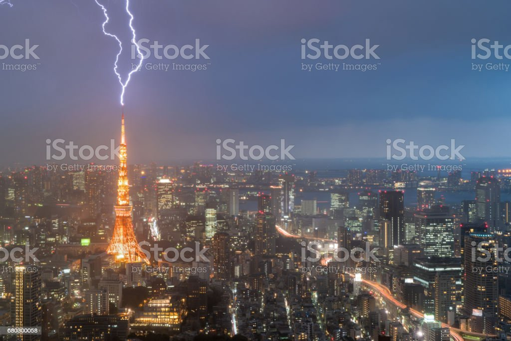 Lightning storm over Tokyo city, Japan in night with thunderbolt over Tokyo tower. Thunderstorm in Tokyo, Japan. stock photo