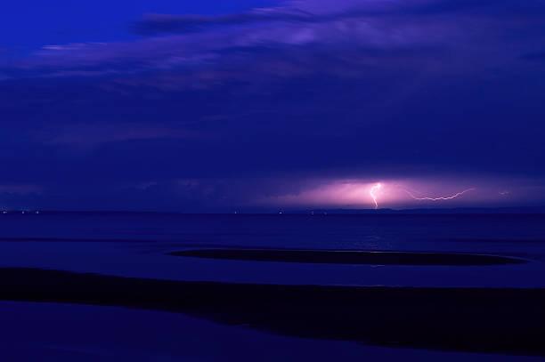 Lightning strike at night over Moreton Island in Queensland Australia stock photo