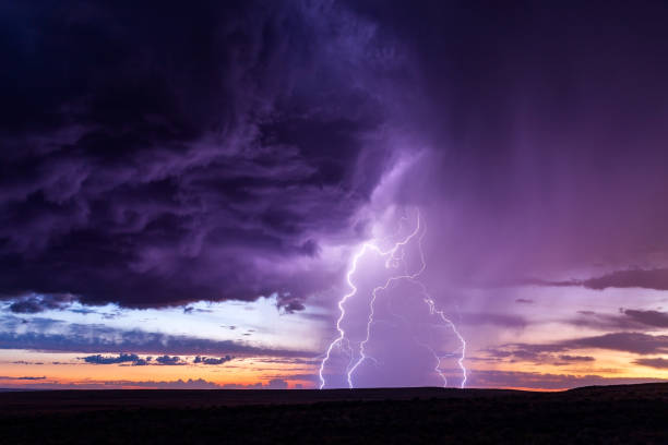Lightning strike at sunset stock photo
