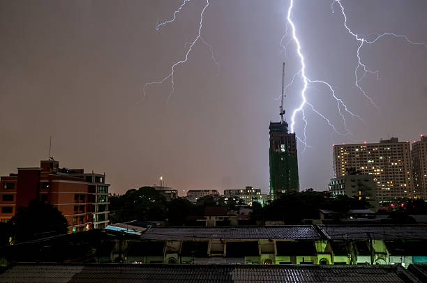 lightning strike in bangkok, thailand - lightning stock photos and pictures