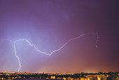 Lightning strike over city at night