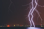 Multiple Lightening on the sea against cityscape at night in Istanbul City, Turkey