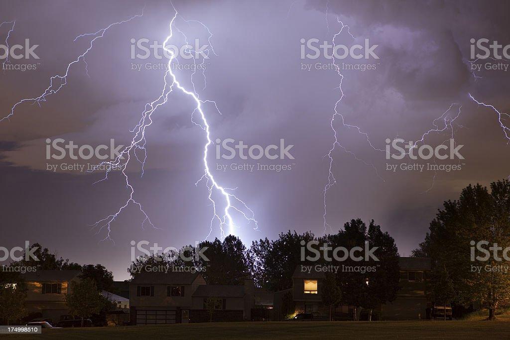 Lightning strike over Denver homes stock photo