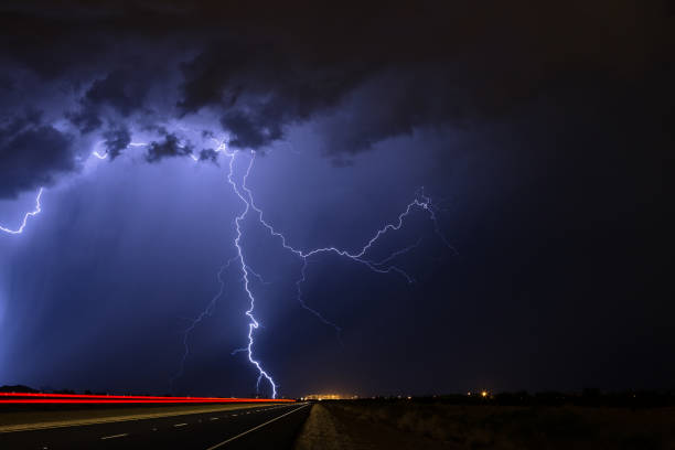 Lightning strikes during a nighttime thunderstorm stock photo