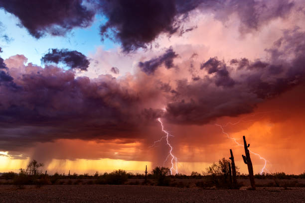 Lightning strikes from a sunset storm in the Arizona desert. stock photo