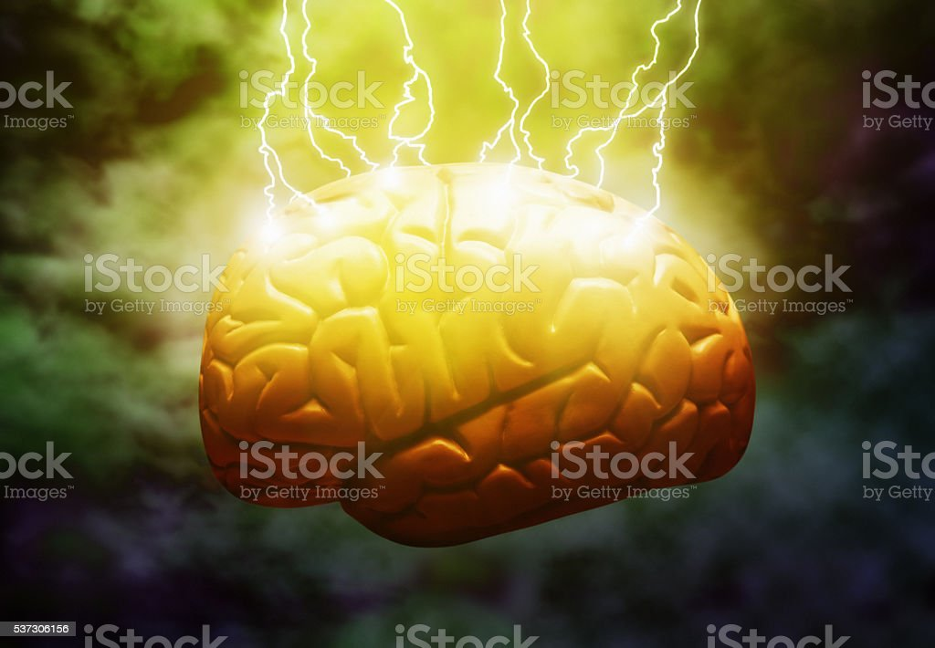 Lightning strikes model brain, electricity, inspiration, headache, Frankenstein, creation, creativity stock photo
