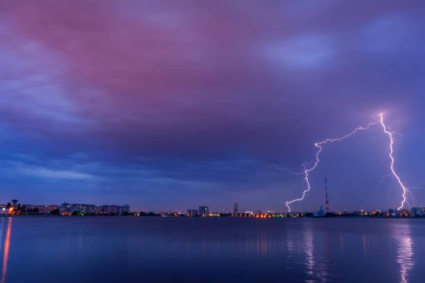 Lightning thunderbolt striking avove the city stock photo