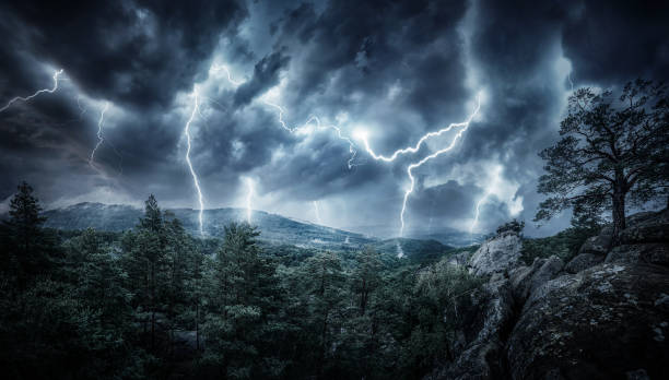 Lightning thunderstorm flash in the mountains. Concept on topic weather, cataclysms (hurricane, Typhoon, tornado, storm) Lightning thunderstorm flash in the mountains. Concept on topic weather, cataclysms (hurricane, Typhoon, tornado, storm) extreme weather stock pictures, royalty-free photos & images