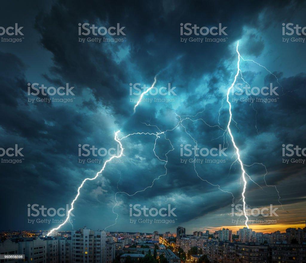 Lightning thunderstorm flash over the night city. stock photo