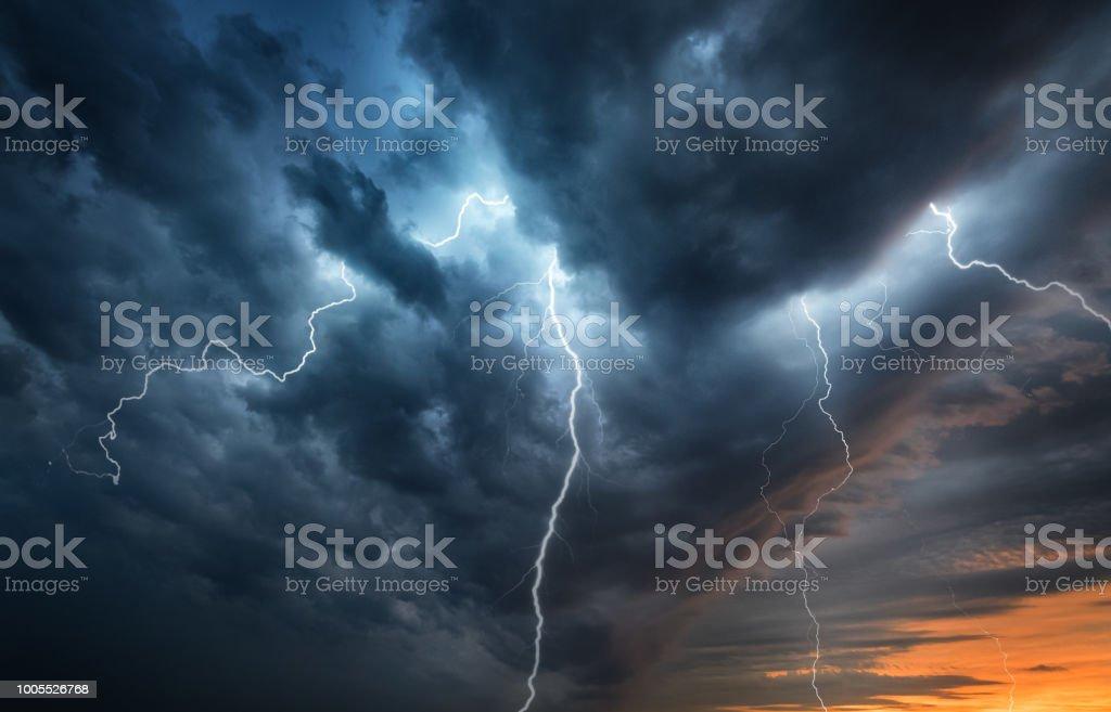 Lightning thunderstorm flash over the night sky. stock photo