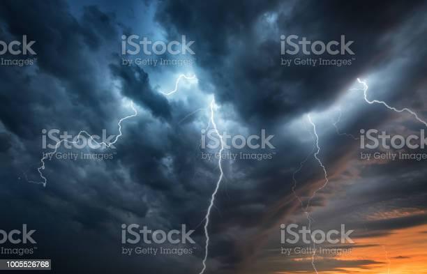 Photo of Lightning thunderstorm flash over the night sky.