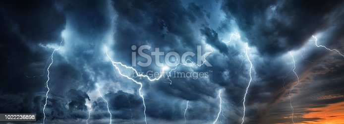 Lightning thunderstorm flash over the night sky. Concept on topic weather, cataclysms (hurricane, Typhoon, tornado, storm)