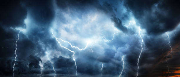 Lightning thunderstorm flash over the night sky. stock photo