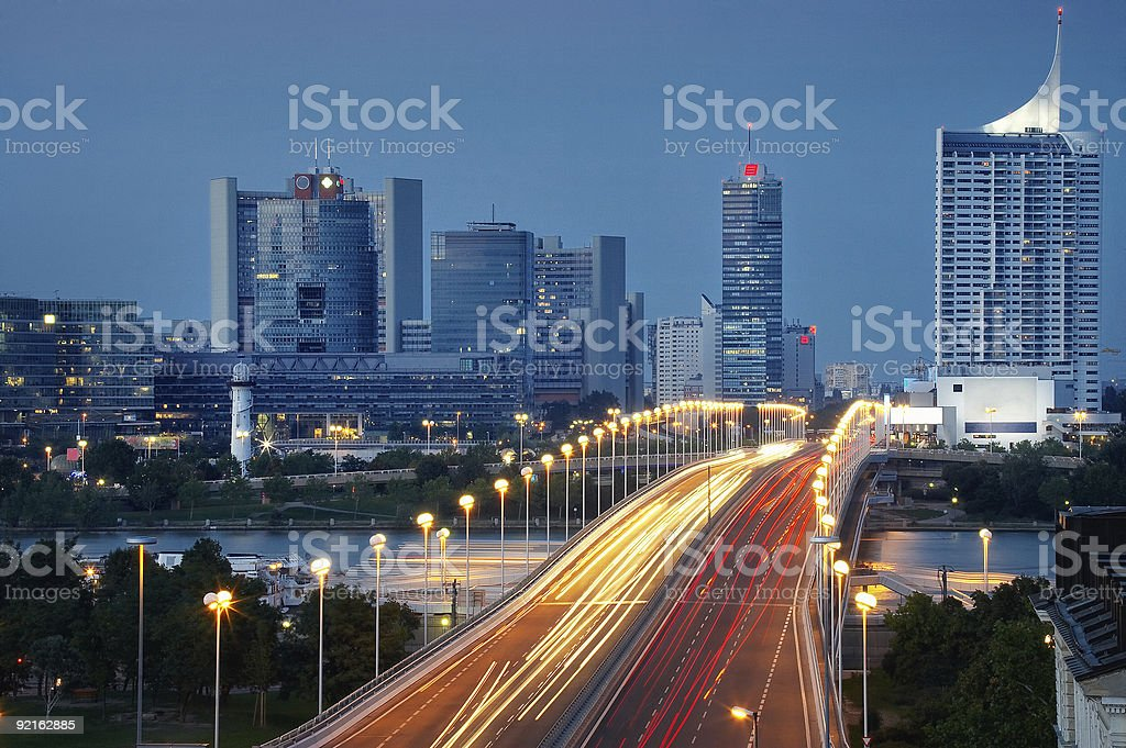 lightning traffic over Danube bridge and Vienna skyline royalty-free stock photo