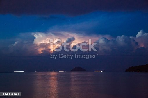 1144340539 istock photo Lightning view by the shore during night time 1140941490
