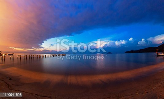 1144340539 istock photo Lightning view by the shore during night time 1140941523