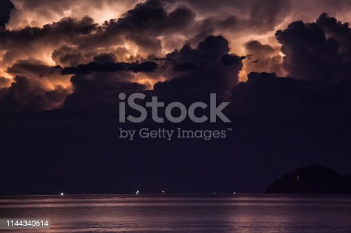 1144340539 istock photo Lightning view by the shore during night time 1144340514
