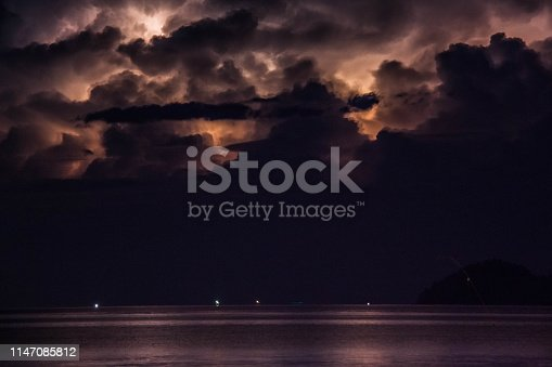 istock Lightning view by the shore during night time 1147085812