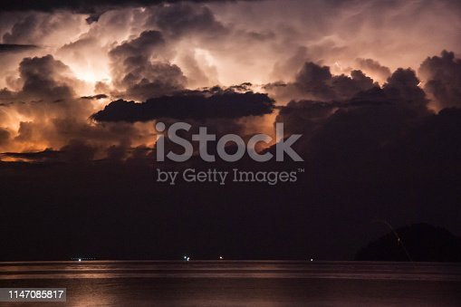 istock Lightning view by the shore during night time 1147085817