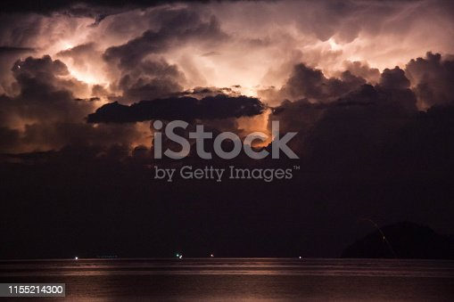 istock Lightning view by the shore during night time 1155214300