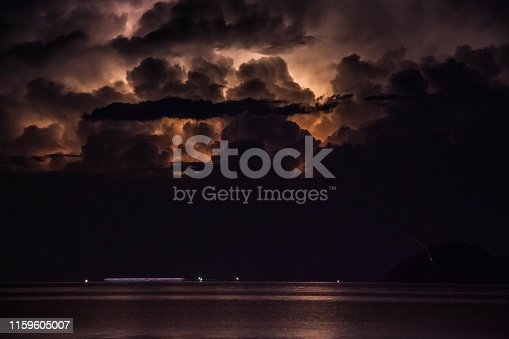 1144340539 istock photo Lightning view by the shore during night time 1159605007
