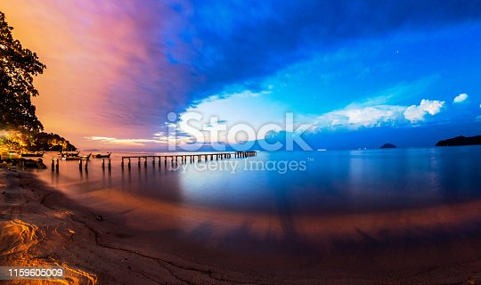 istock Lightning view by the shore during night time 1159605009