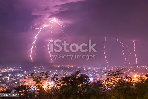 istock Lightning with dramatic clouds.Night thunder-storm over city 680237922