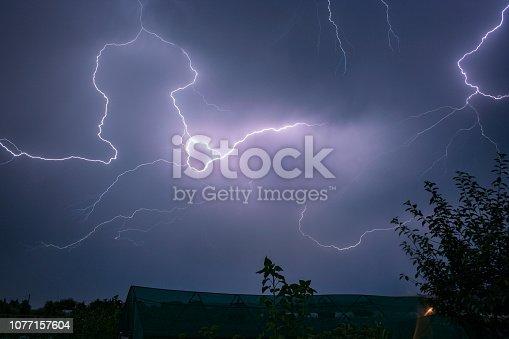 656192770istockphoto A lightningbolt creeps through the clouds over Transylvania, Romania 1077157604