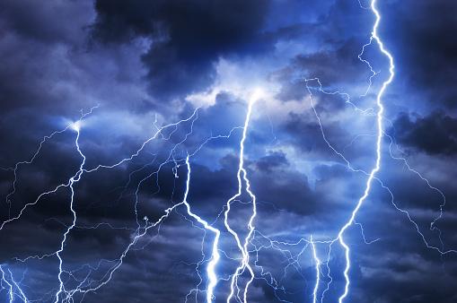 Thunder, lightnings and rain during summer storm.