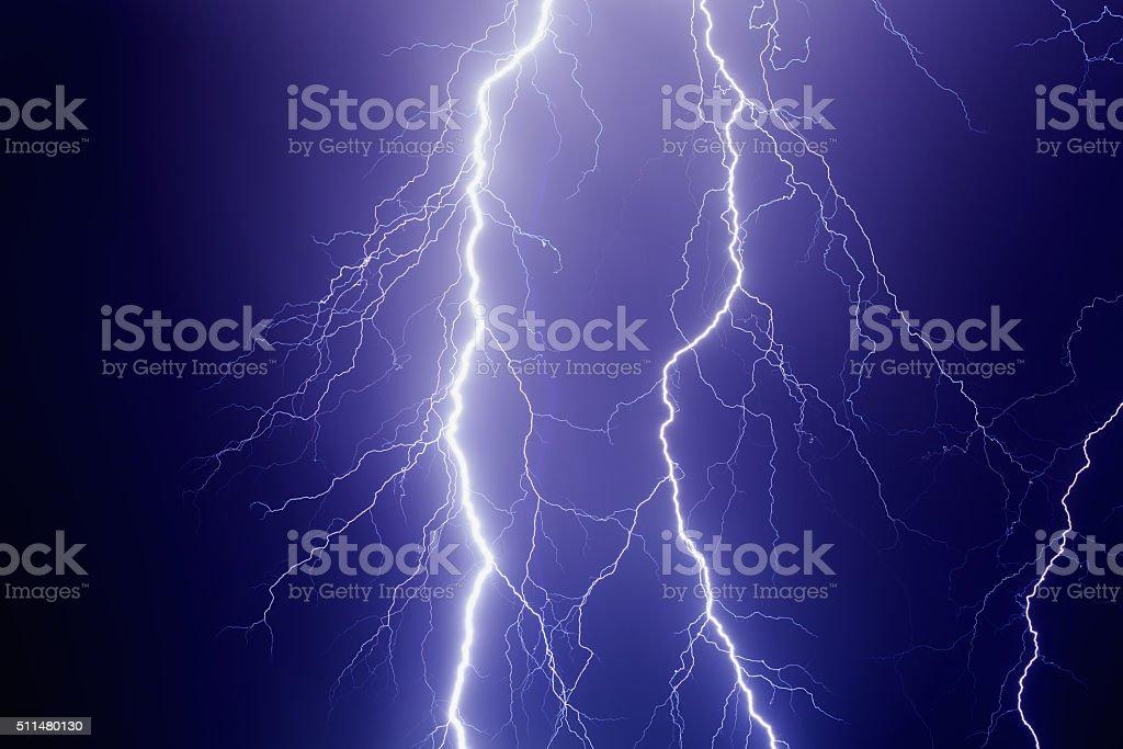 Lightnings in dark stormy sky stock photo