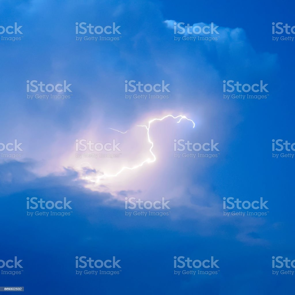 Lightnings in storm clouds. Peals of a thunder and the sparkling stock photo