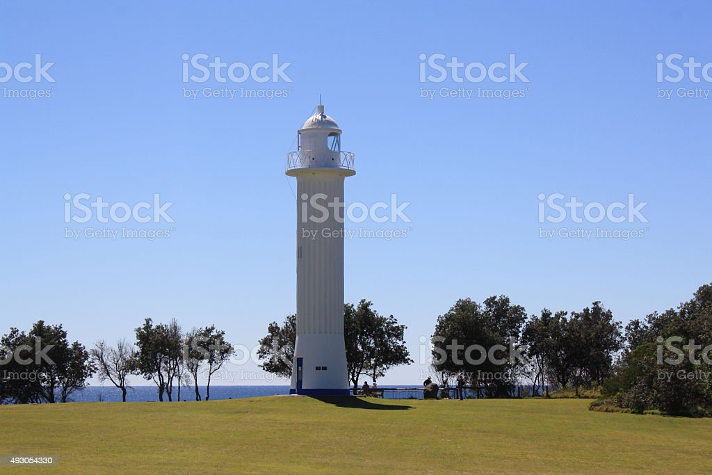 Lightouse and grass and ocean stock photo