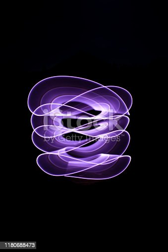 Curved abstract shape made with a light saber violet.