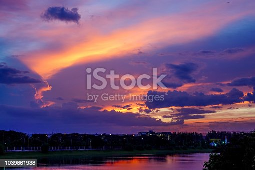 917116520 istock photo lights abstract city at night with dark blue black color bokeh sky and cloud. 1039861938