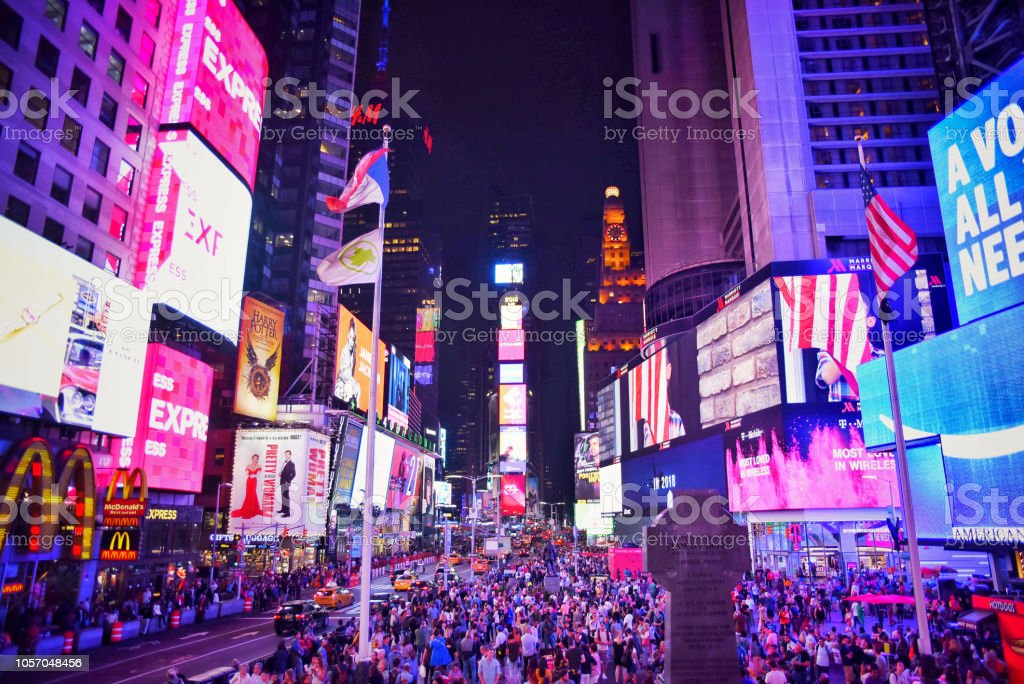 Lights and people, the typical stamp in Times Square at night stock photo